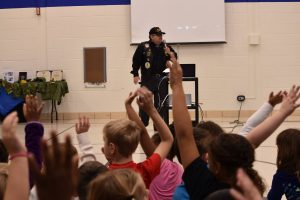 Joe speaks to students at Grewenow Elementary school on Veterans' Day