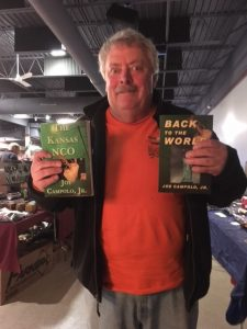 Man holds up Joe's books