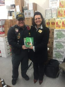 Joe stands with Judge Jodi Meier both holding his books
