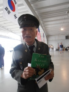Vietnam War Veteran from the Republic of Korea holds up Joe's book